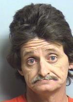Arrested for improper display of a license plate.