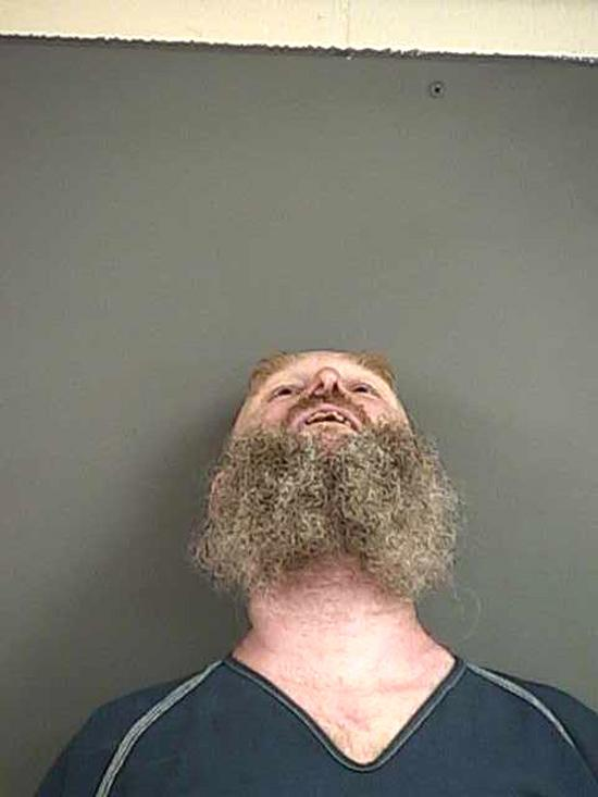 Arrested for violating parole, criminal mischief.