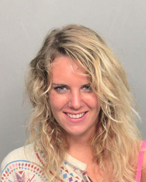 Arrested for cocaine possession, loitering, and resisting an officer.
