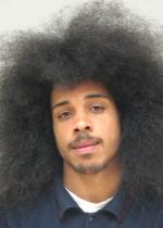 Arrested for obstructing police, probation violation.