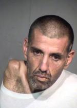 Arrested for drug possession, violating probation.