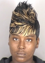 Photographed by the sheriff as part of her criminal registration.