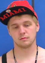 Arrested for discharging a weapon, robbery, and injury to property.