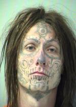 Arrested for burglary, property damage.