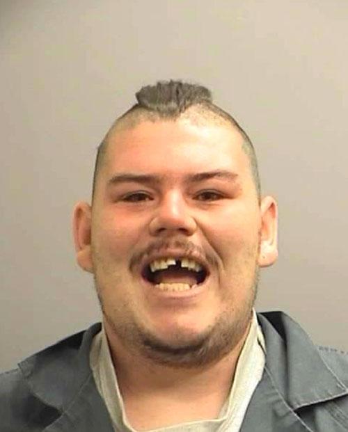 Arrested for a parole violation.