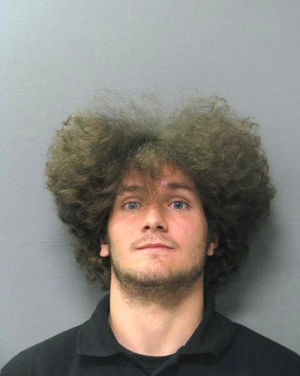 Arrested for theft, disturbing the peace, and resisting an officer.
